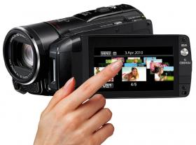 Canon Legria HF M32 camcorder showing its 3D screen screen in action.